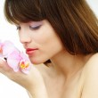 Woman with an orchid — Stock Photo #6145784