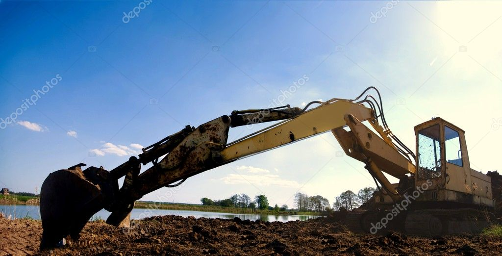 Digger, Heavy Duty construction equipment parked at work site  — Stock Photo #5660472
