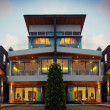 View of nice modern villa in  summer after dark  environment - Stock fotografie
