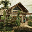 Stock Photo: View of nice stylish summer villa in tropic environment