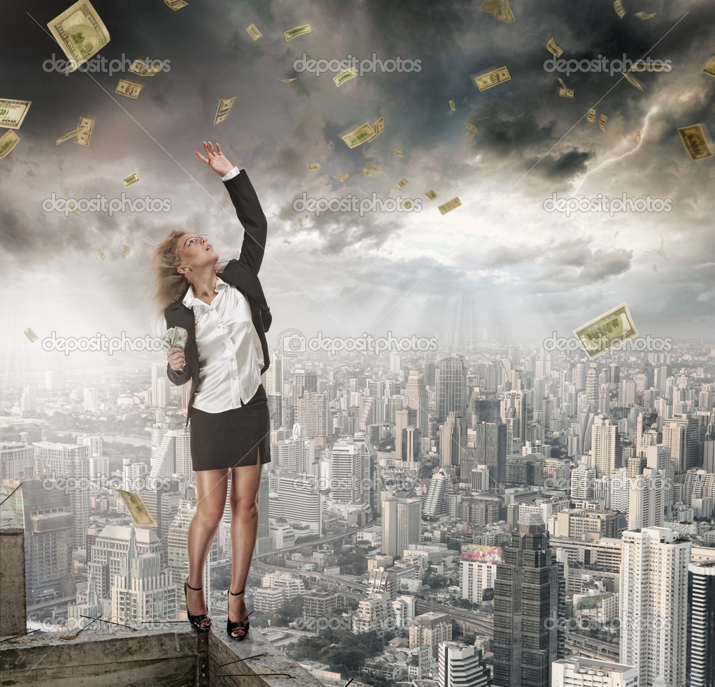 Portrait of young woman catching money on color background  Stock Photo #5961450