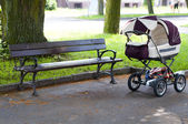 Pram in the park — Stock Photo