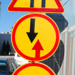 Three yellow traffic signs — Stock Photo