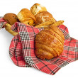 Croissant and muffins in a basket with a napkin — Stock Photo #5642947