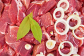 The texture of the meat, laurel leaf and onion — Stock Photo