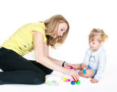 Mother and the daughter mold plasticine — Stock Photo