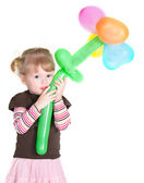 Little girl with baloons flower — Stock Photo