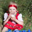 Little girl with milk glass on hay — Stock Photo #6604540