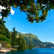 Stock Photo: Lugano city lying on lake Lugano