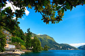 Lugano city lying on the lake Lugano — Stock Photo