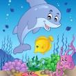 Happy dolphin at sea bottom 1 — Stock Vector #5755630