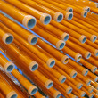 Abstract yellow tube heap, industry details — Stock Photo