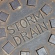 Rain water, street metal construction details - Stock Photo