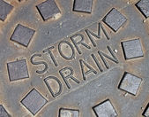 Rain water, street metal construction details — Stock Photo