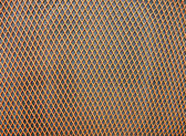 Abstract orange grid surface, closeup plastic background. — Stock Photo