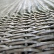 Stock Photo: Silver metallic grid, metal corrosion, industry details.