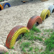 Stock Photo: Refused color tyre heap on sand, recycling concept.