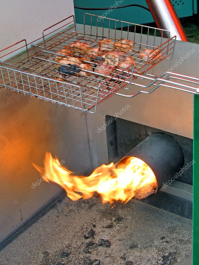 Roasted meat, food preparation with fire, modern kitchen details — Stock Photo #6463333