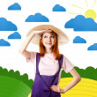 Stock Photo: Young girl in overalls at art countryside.