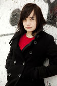 Fashion teen girl at white graffiti background. — Stock fotografie