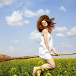 Redhead enchantress fly over spring rapeseed field at broom. — Stock Photo #5544667