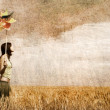 Girl with wind turbine at wheat field. Photo in old color image — Stock Photo #5564050