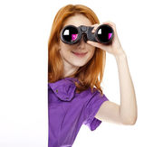 Teen redhead girl with binoculars isolated on white background — Stock Photo
