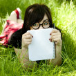 Young teen girl with notebook at green grass. — Stock Photo