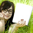 Young teen girl with notebook at green grass. — Stock Photo #5633294