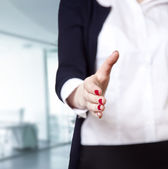 Business woman smiling and hold hand for handshake. — Stock Photo
