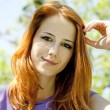 Beautiful redhead girl at the park in summer time. — Stock Photo #5745123