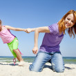 Two happy sisters at summer beach. — Stock Photo #5745177
