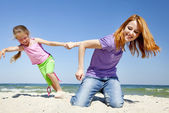 Two happy sisters at summer beach. — Stock Photo