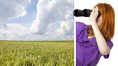 Teen redhead girl with binoculars looking at wheat field from co — Stock Photo