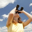Girl with binocular watching in sky. — Stock Photo #5961470