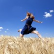 Redhead girl at wheat field in summer day. — Stock Photo #5961596