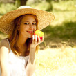 Beautiful redhead girl with fruit at garden. — Stock Photo #5961651
