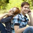 Couple calling by mobile phone at outdoor in summer time. — Стоковая фотография