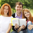 Three students at outdoor doing homework. — Stock Photo #6024704