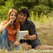 Two students at outdoor doing homework. — Stock Photo #6024856