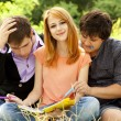 Three students at outdoor doing homework. — Stock Photo #6024896