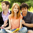 Three students at outdoor doing homework. — Stock Photo #6024911