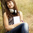 Young teen girl doing homework at the park. — Stock Photo