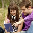 Two students at outdoor doing homework. — Stock Photo #6025214