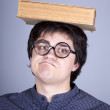 Young men thoughtful men with book over head. — Stock Photo #6025320