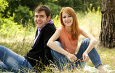 Couple relax at outdoor in summer time. — Stock Photo
