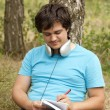 Student with notebook and headphones. — Stock Photo