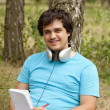 Stock Photo: Student with notebook and headphones.
