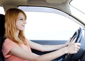Redhead girl in the car. — Stock Photo