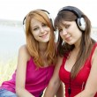 Royalty-Free Stock Photo: Two teenage girls listening to MP3 player